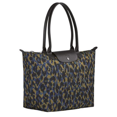 Dimensions : 30 x 31 x 19 cm Material : Polyester canvas with inside coating Trimming : Cowhide Lining : Polyamide - Jacquard, Longchamp history (for all models except for Le Pliage shapes, Le Pliage shapes no lining) Accessories finishing : Nickel Weight : 241 g